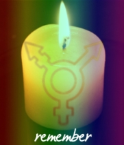 rainbow candle with trans remembrance stamp on it