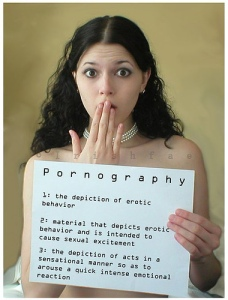 naked woman holding pornography sign